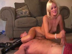 A smiling blonde wife pinned her husband down on the floor for some hot hand action